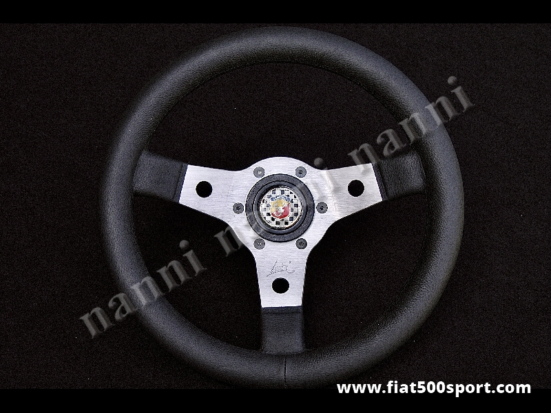 Art. 0010 - Fiat Abarth 595 Fiat Abarth 695 leather steering wheel with hub (satined spokes). - Fiat Abarth 595 Fiat Abarth 695 leather steering wheel with hub (satined spokes) Outer diameter 315 mm.