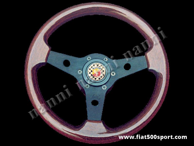 Art. 0016 - Volante Fiat 500 Fiat 126 Abarth in mogano con razze nere completo di mozzo e pulsante clacson Abarth. - Volante FIAT 500 Fiat 126 Abarth in legno di mogano con razze nere, completo di mozzo e pulsante clacson Abarth. (specificare nelle note se lo si desidera con mozzo per 126). Il diametro esterno è di 315 mm. (PREZZO DI COSTO).
