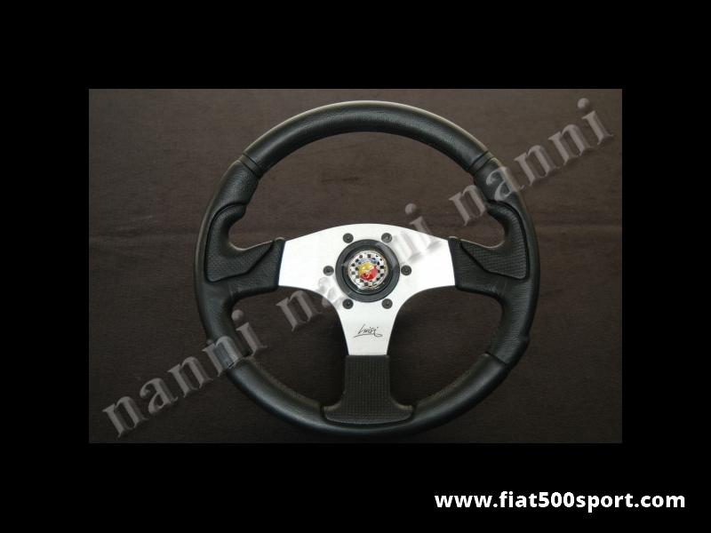 Art. 0051 - Volante  Fiat  500 Abarth con razze satinate completo di mozzo e pulsante clacson Abarth. - Volante Fiat 500 Abarth con razze satinate.(specificare se lo si desidera con mozzo per 126). Il diametro esterno è di 320 mm.
