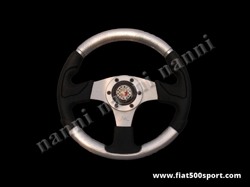 Art. 0055 - Volante Fiat 500 Fiat 126 Abarth in pelle color argento, completo di mozzo e pulsante clacson Abarth. - Volante Fiat 500 Fiat 126 Abarth in pelle color argento.(specificare nelle note se lo si desidera con mozzo per 126). Il diametro esterno è di 320 mm.