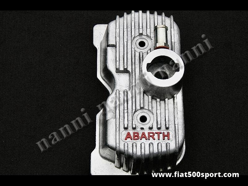 Art. 0262 - Coperchio punterie Abarth Fiat 500 D F L R Fiat 126 in alluminio. - Coperchio punterie Abarth Fiat 500 D F L R Fiat 126 in alluminio. Questo coperchio richiede il tappo introduzione olio ART. 0266. Con questo coperchio punterie si può montare anche il carburatore Weber diam. 26/28 mm. originale.