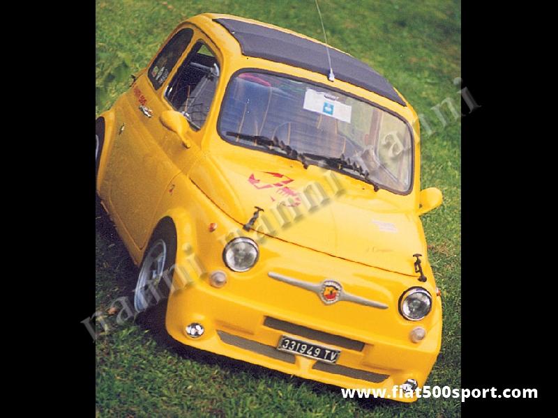 Art. 0856 - Paraurti Fiat 500 anteriore NANNI in vetroresina con spoiler e predisposizione fari. - Paraurti Fiat 500 anteriore NANNI in vetroresina con spoiler e predisposizione fari. Si monta con le staffe di supporto originali ed è verniciabile in qualsiasi colore. Si possono montare fari antinebbia Fiat Lancia.